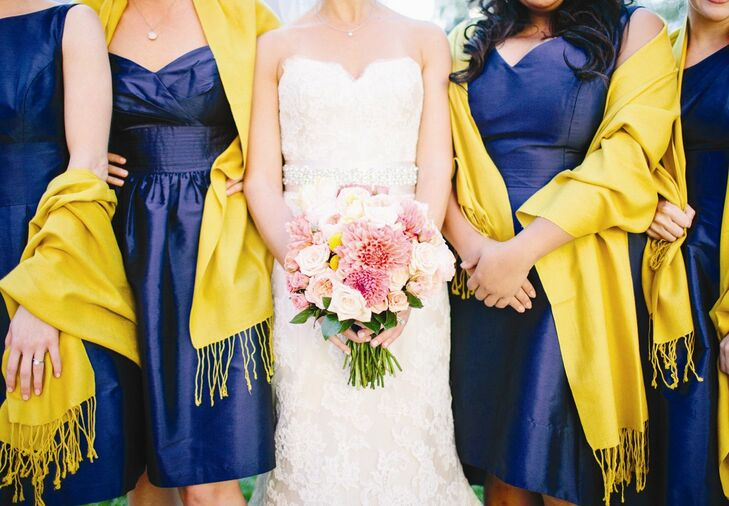 The bride carried a bouquet filled with yellow billy balls and light pink dahlias and garden roses.