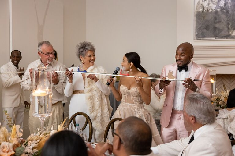 jeannie mai and jeezy take a shot at the reception