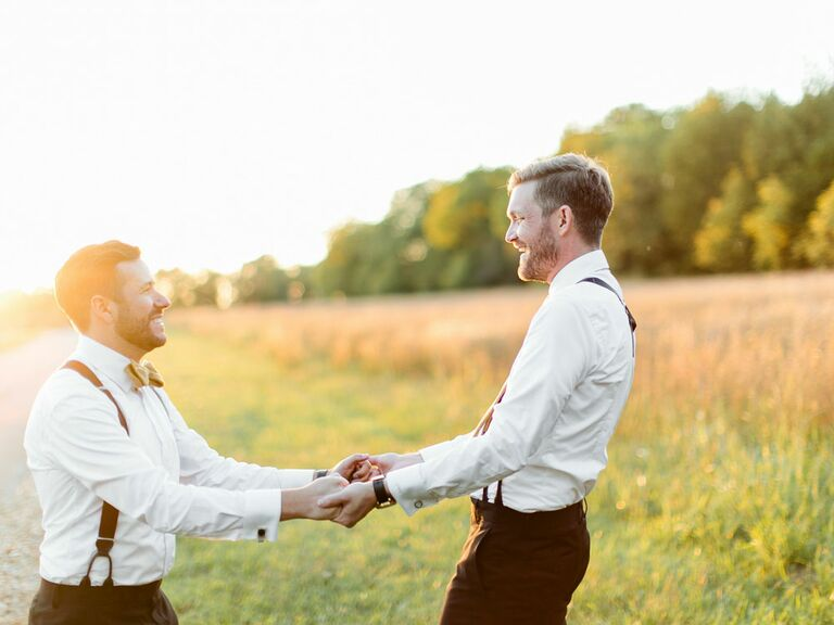Grooms wearing cottagecore fashion on wedding day in field
