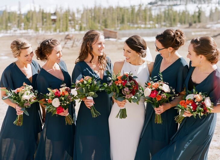 """The bridesmaids wore jade-colored maxi dresses for the ultimate in comfort. """"Two of the five bridesmaids were breastfeeding, so choosing a dress with the ability to wear a normal bra was essential,"""" Liz says."""