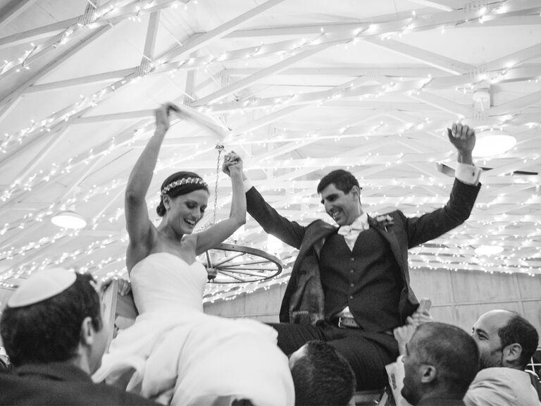 Jewish wedding hora chair dance