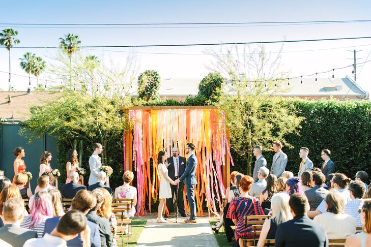 Outdoor Ceremony with Colorful, Bright Wedding Arch