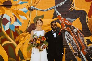 Couple Poses in Front of Street Art Mural in Detroit, Michigan