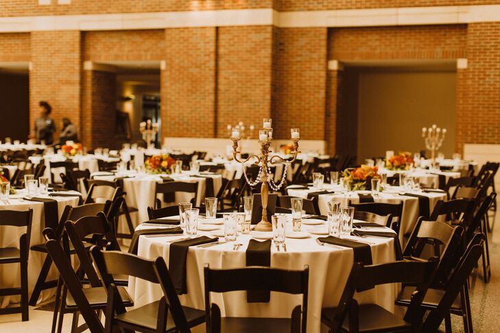 Simple Reception Decor With Folding Chairs and Candelabras