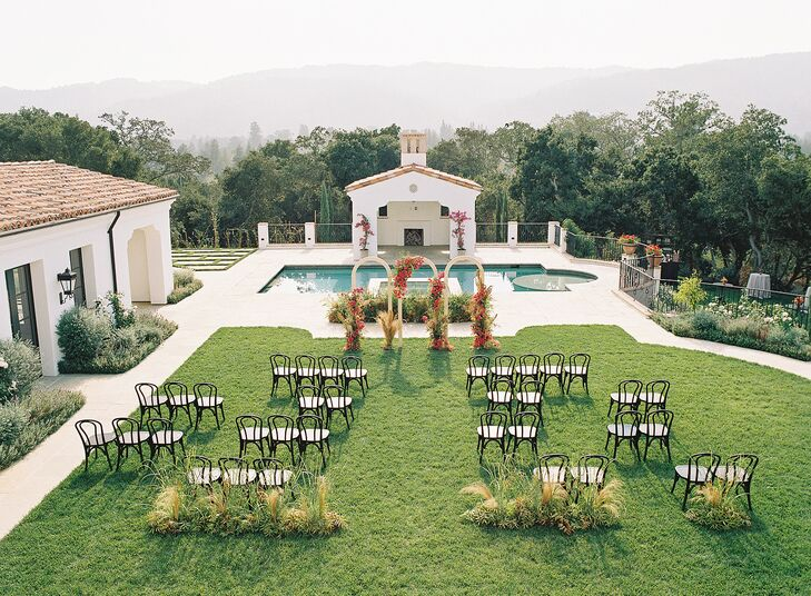 The Wedding Ceremony Took Place on a Lawn Overlooking a Pool and Estate