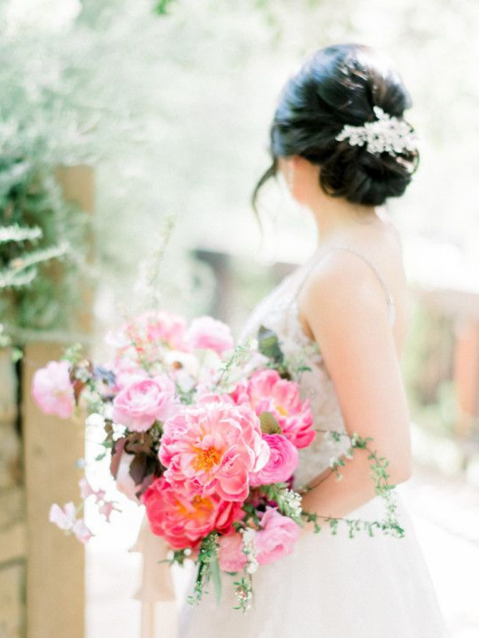 bride holding coral charm peony bouquet