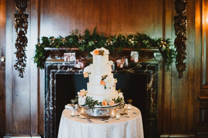 Elizabeth and Mike's cake was a three-tier ivory cake accented with fresh olive branch greens and peonies. Mantels throughout the reception were decorated with dark green garlands with peach berries.