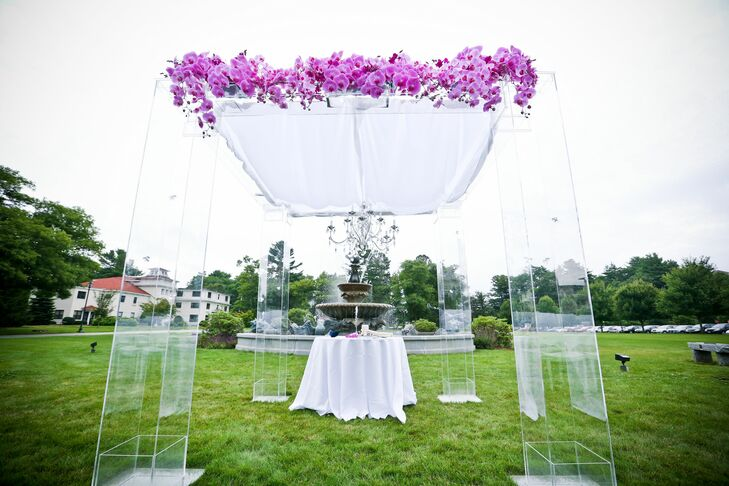 Sharon and Chris were married beneath a Lucite huppah topped with a canopy of fuchsia phalaenopsis orchids.