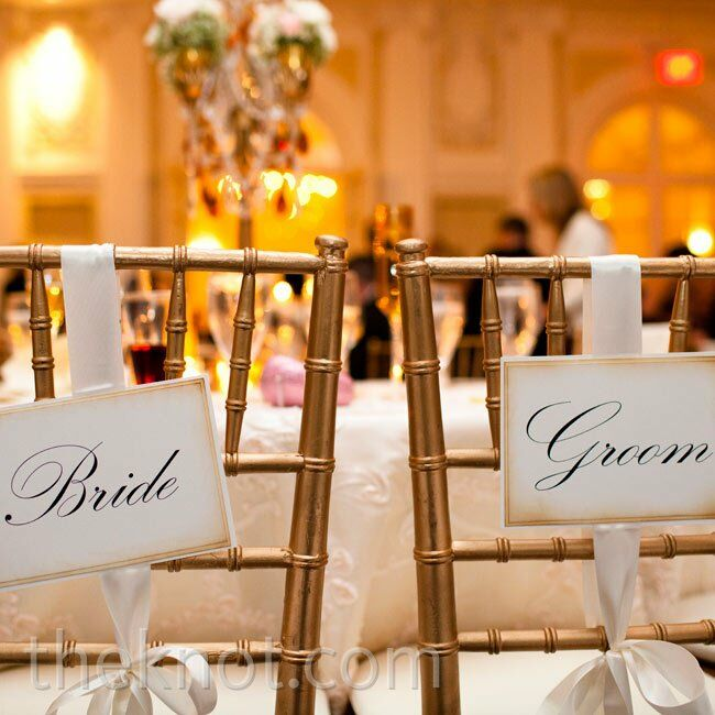 Bride and Groom signs hung from the couple's seats at the reception.