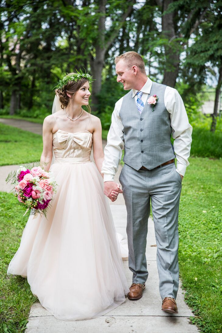 """Caleb wore gray slacks, a gray vest, a white button-down and a pastel tartan plaid tie. The groomsmen echoed his look, but decided to forgo the vest and wear suspenders. Since Hannah wore a bright pink petticoat under her dress, Caleb donned neon green socks. """"I felt like it was just a little bit of our spunky sides peaking out,"""" Hannah says."""