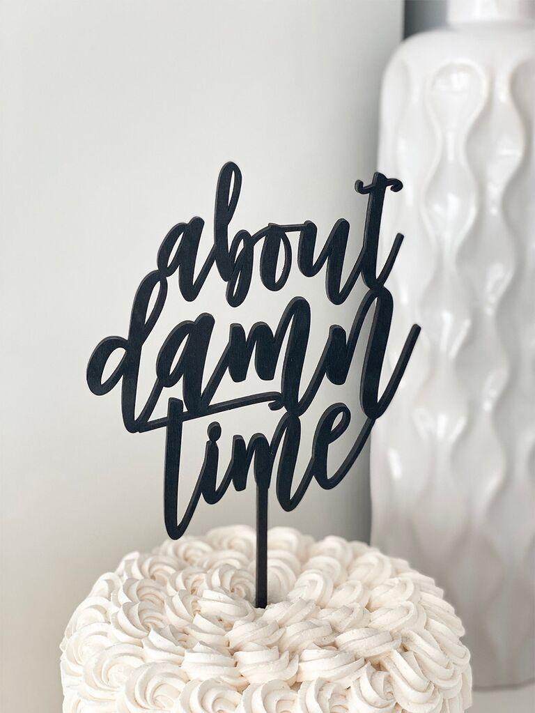 'about damn time' in modern black script