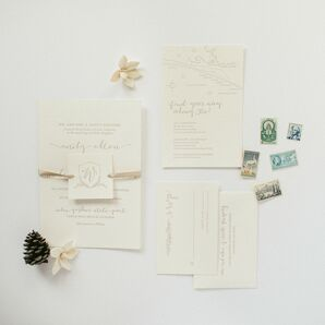 White Wedding Invitations and Paper Goods With Stamps
