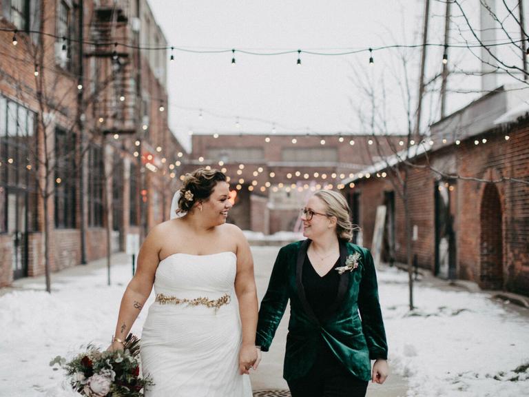 wedding season couple holding hands in winter