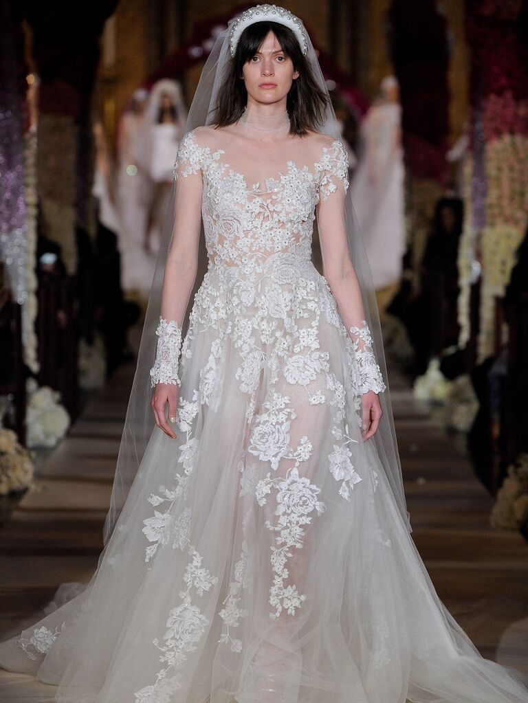 Reem Acra Spring 2020 Bridal Collection floral embroidered lace A-line wedding dress with illusion long sleeves
