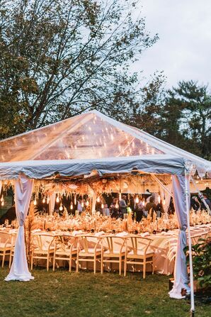 Blush Tones and Yellow Lights Added to the Tented Wedding Reception's Cozy Ambiance