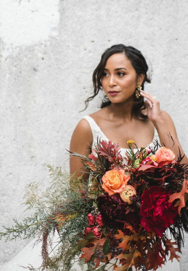 Bride holding large red bouquet