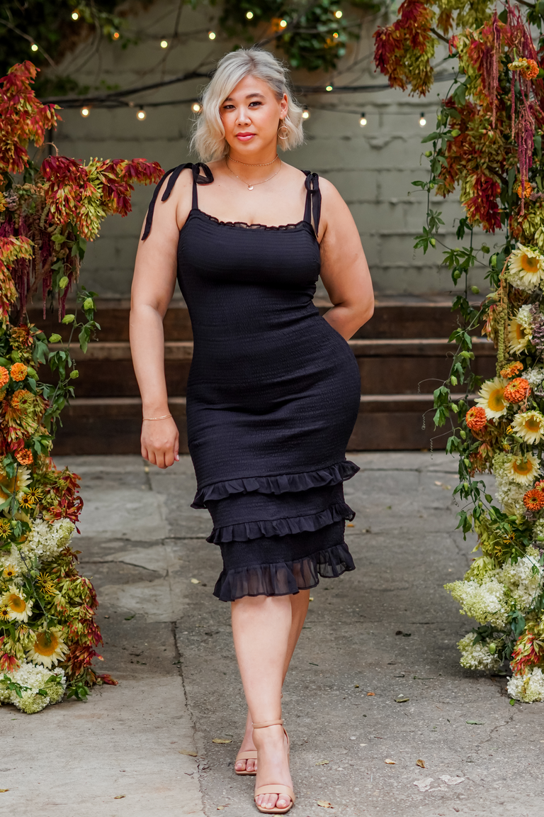 """Abercrombie x The Knot's """"Best Dressed Guest"""" Collection black midi dress with ruffle skirt"""