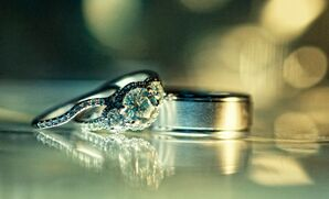 Three Stone Diamond Ring with Twisted Setting