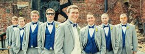 Groom and Groomsmen in Gray Tuxedos and Blue Bow Ties