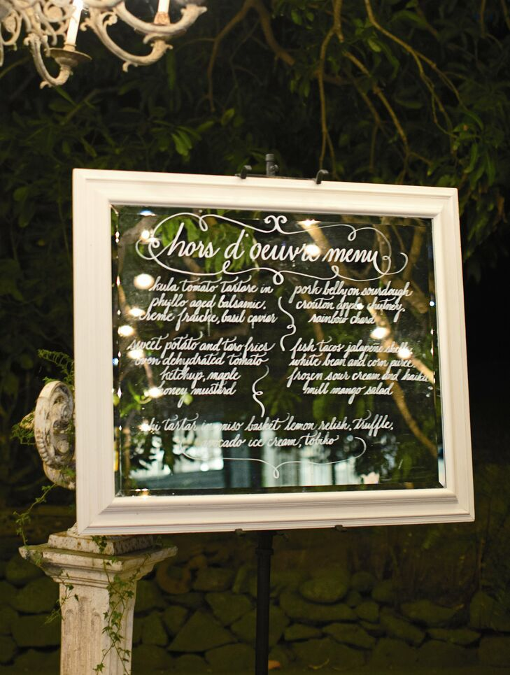 As guests transitioned to cocktail hour, they were greeted with an hors d'oeuvres menu written in calligraphy.