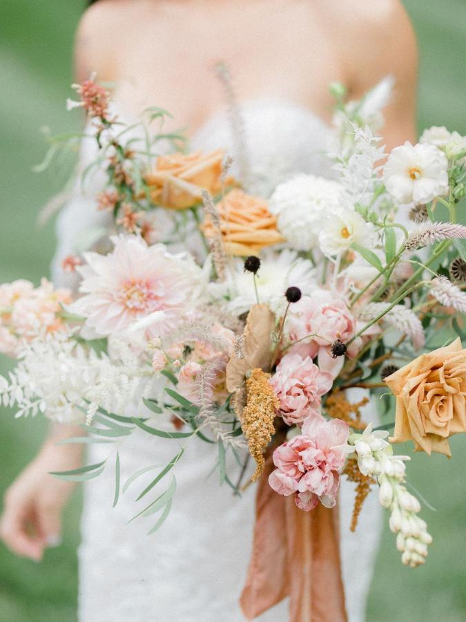 Orange-hued wildflower wedding bouquet