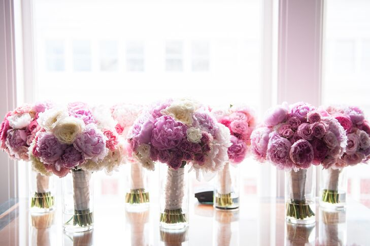 The pink and white bridesmaid bouquets (filled with roses and hydrangeas) had a double purpose -- hand-held ceremony bouquets and head table centerpieces at the reception.