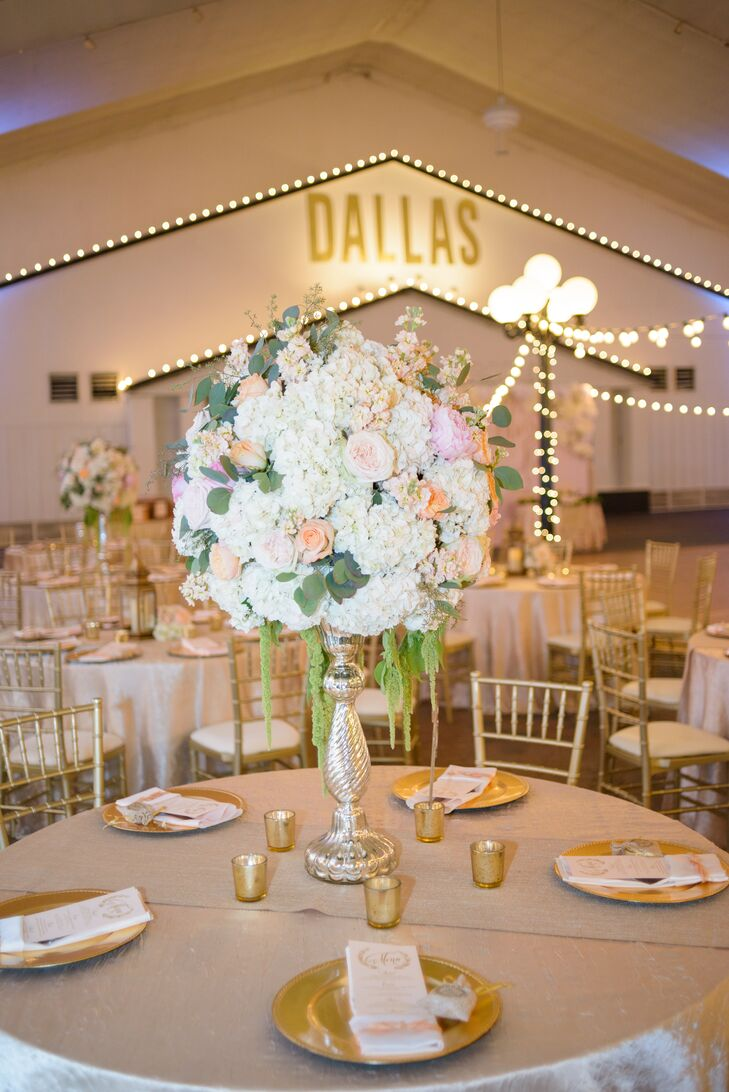 Lush arrangements of white hydrangeas, blush garden roses, stock, hanging amaranthus and eucalyptus in tall silver vases decorated the neutral dining tables. Low gold votives, gold chargers and gold chiavari chairs continued the metallic motif.