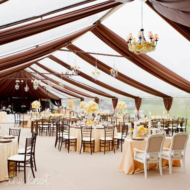 Draping chandeliers and candles added interest to the airy tent.