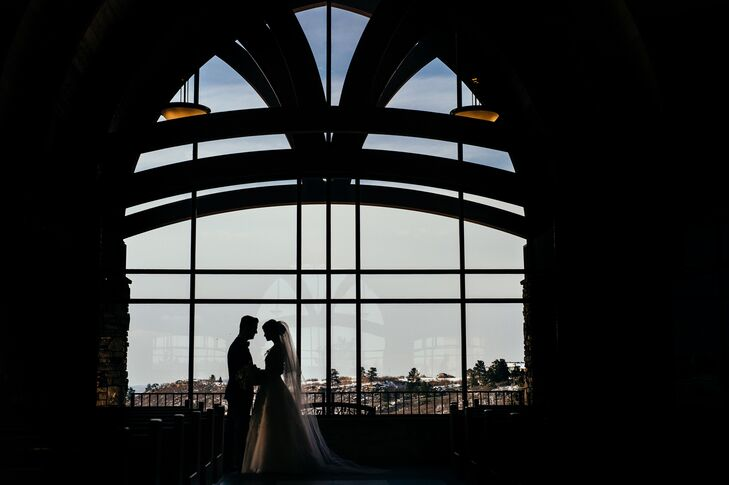 """""""The church is absolutely stunning, and it sits up on top of a hill overlooking Castle Rock,"""" Meagan says. """"The priests and coordinators there were very welcoming and happy to work with out-of-state couples. I loved that it represented all the tradition of the church that I'd grown up with, but that everyone was also open to including parts of James' background (Episcopalian) and allowing his family priest to take part in our ceremony."""""""