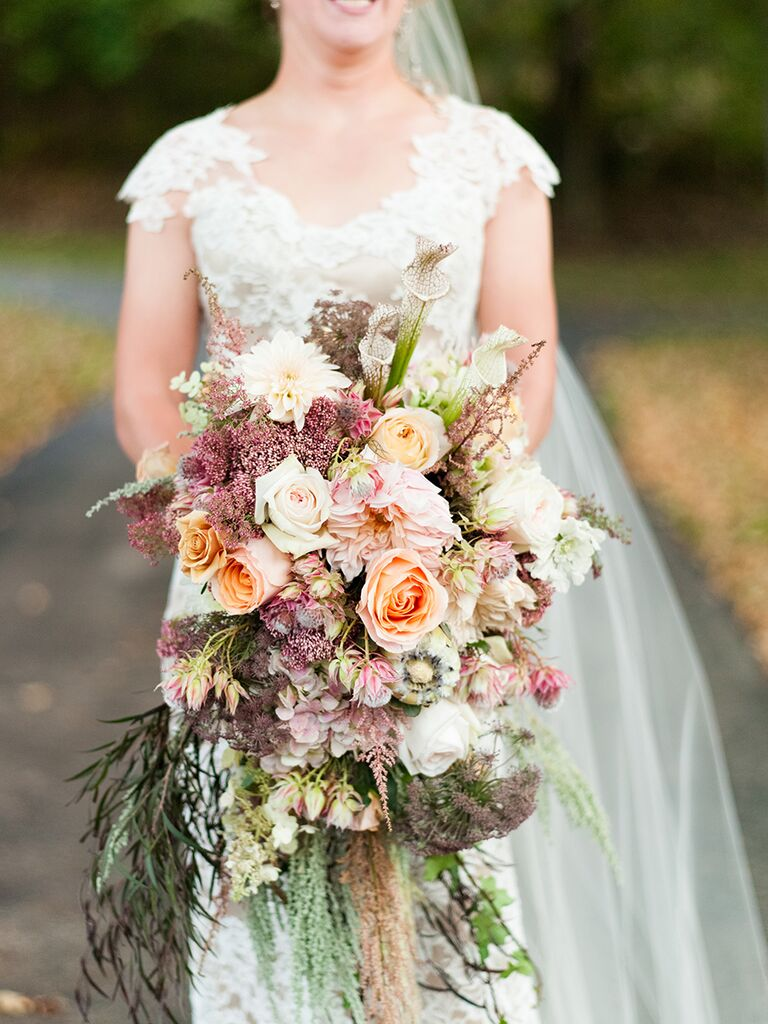 Cascading wedding bouquet idea with dahlias and hydrangeas