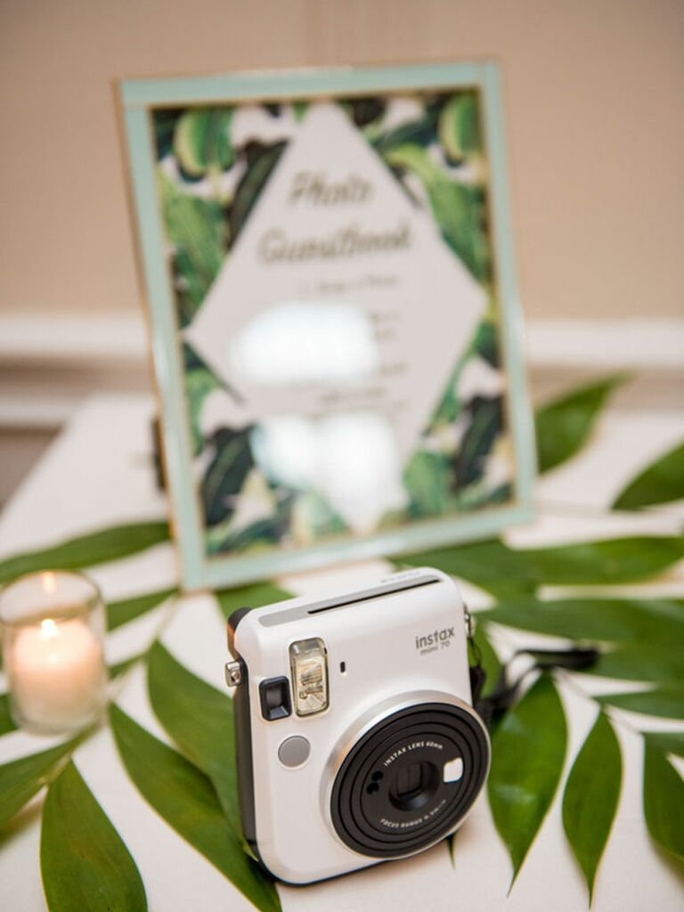 Wedding photo booth table with framed wedding hashtag sign