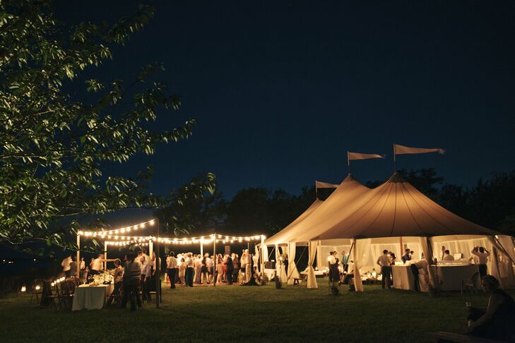 Guests dance late into the night on an open dance floor under romantic lights.