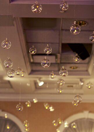 Hanging glass globe wedding decor: Clark+Walker Studio / TheKnot.com