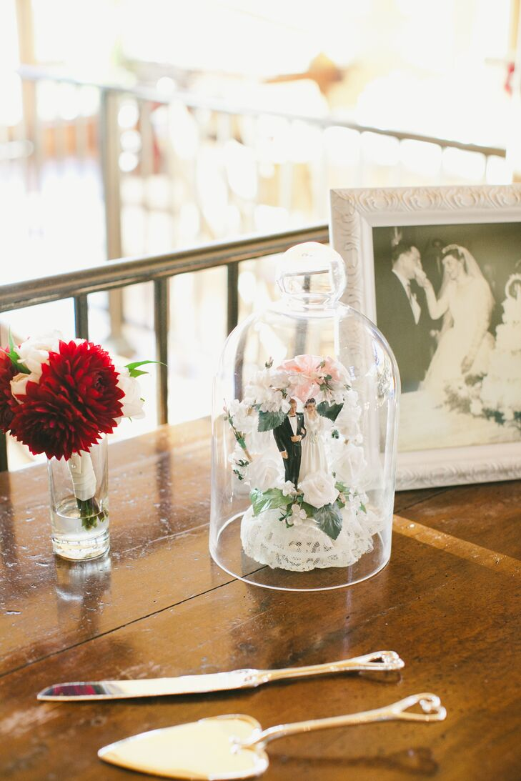 To bring a familial element to the decor, Nicki and Jordan decorated their cake table with photos of their parents and grandparents on their wedding day, as well as a cake topper that had belonged to Nicki's grandparents.