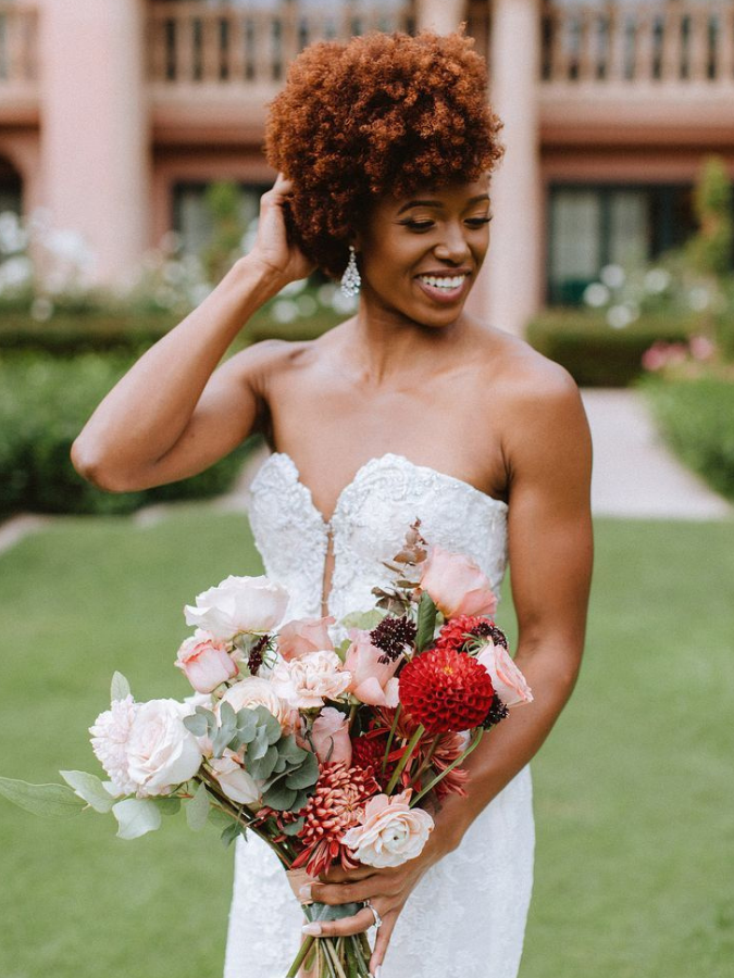 Bride holding pink-and-red bouquet