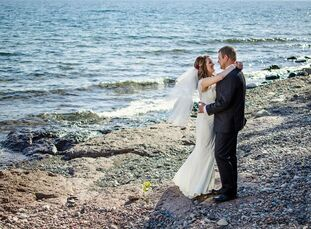 Bailee Dickson (26 and a registered nurse) and Jordan Kopp's (27 and a student) natural, elegant wedding was surrounded by a deep rich purple color pa