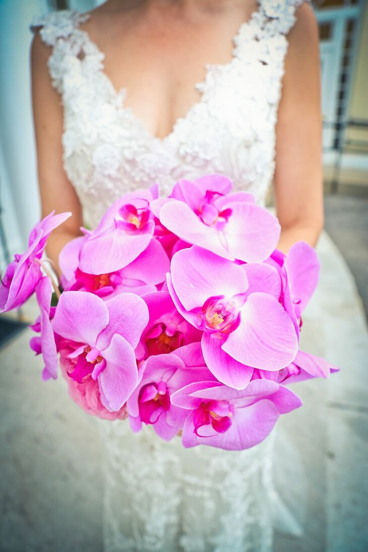 Sharon carried a bright, monobotanical bridal bouquet of fuchsia phalaenopsis orchids.
