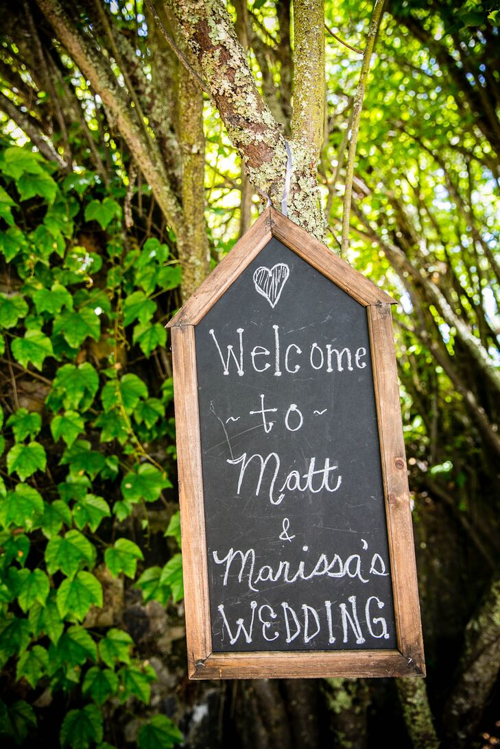 A chalkboard sign welcomed guests to the ceremony and reception venue.