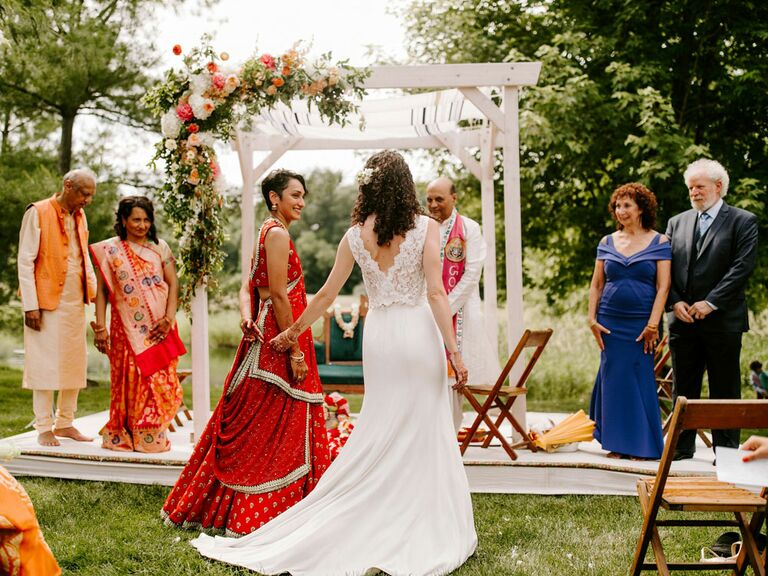 Brides walking to the altar during multi-cultural wedding ceremony