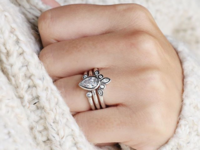 pear-shaped bezel engagement ring with nesting bands