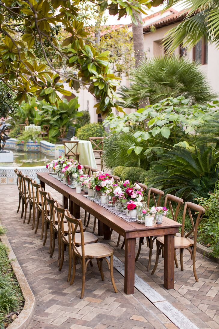 Alicia and Ian kept their dinner reception look casual by forgoing linens and topping tables with runners and blooms.