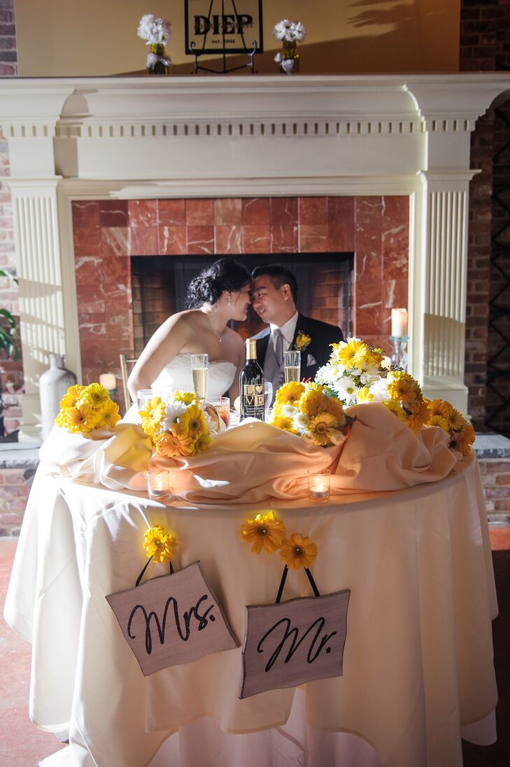 Lush yellow gerbera daisies decorated the couple's sweetheart table.