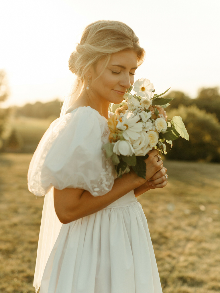 how to gua sha before wedding bride with bouquet