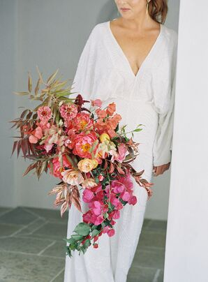 Bride in White Jumpsuit With Cascading Bougainville Bouquet