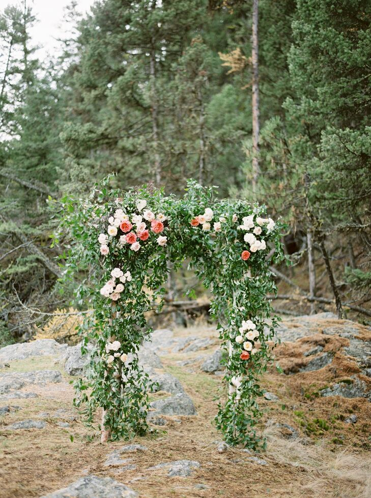 """""""The arbor that Habitat Floral Studio created was a dream come true,"""" Sarah says. """"It was covered with eucalyptus and roses and spray roses in soft fall colors. I have a framed photo of just the arbor alone in my house that I will never get sick of looking at."""""""