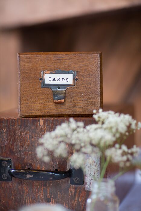 Guests left cards in a vintage library card drawer.