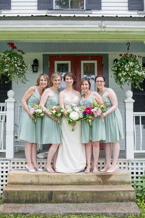 The bridesmaids wore knee length mint dresses with different necklines.