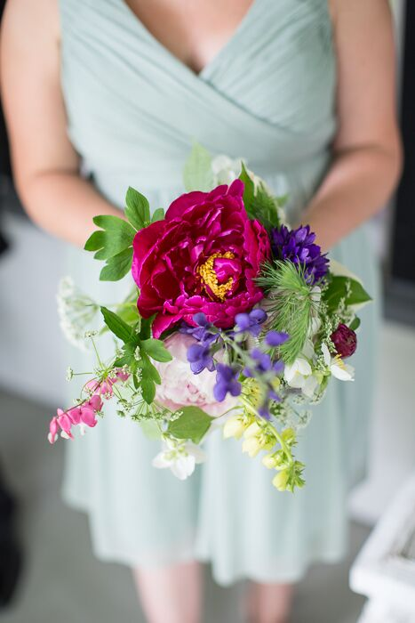 A large bright fuchsia peony was the center of the rustic bridesmaid bouquets.