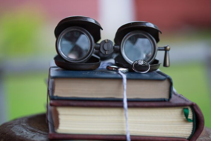 Vintage props like old books and antique binoculars added a whimsical touch to the wedding decor.