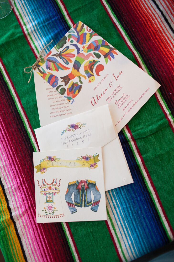 """Alicia's artist friend Sogoal Zolgadri of Sogi's Honey Bakeshop created the artwork for their save-the-date—a bullfighting jacket and a Mexican embroidered dress under a flowered banner with the couple's names. """"She blew us away with the fabulous watercolor image she painted,"""" Alicia says. """"We loved her painting so much, we used the image throughout almost every aspect of the wedding."""""""